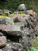 Close Up Of A Natural Stone Fence On Mountain Pasture poster