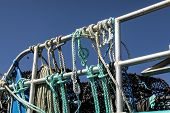 Ropes And Lobster Pots Tiied To The Railings On The Promenadeon The Beach At St Brelade, Jersey, Cha poster