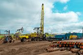 Workover Rig Working On A Previously Drilled Well Trying To Restore Production Through Repair. The P poster