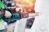 Ice Sculpture Carving Man Use Chainsaw Cut Frozen Winter poster