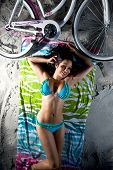 Young Pretty Brunette Woman Laying on Beach At Night
