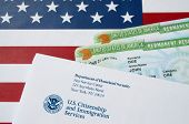 United States Permanent Resident Green Cards From Dv-lottery Lies On United States Flag With Envelop poster