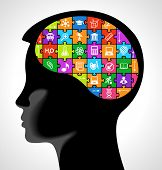 silhouette of a child head with the brain of the puzzles and education icons.. the concept of educat