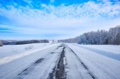 Winter Landscape. Road Through Fields, Forest And Hills Extending Into The Distance. Salair Ridge. W poster