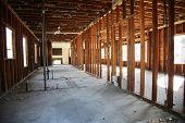 Home or Building Demolition. Remodeling of a Home or Office Building. An empty building with the wal poster