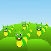 Four Amusing Caterpillars On A Green Lawn