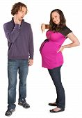 pic of gullible  - Pregnant woman pointing at womb next to surprised man - JPG