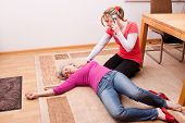 image of resuscitation  - blond young woman makes an emergency call - JPG