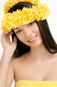 Portrait of a sexy woman with wreath of yellow flowers.