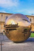 Sphere Within Sphere In Courtyard Of The Pinecone At Vatican Museums. Golden Ball In Vatican