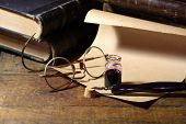 foto of inkpot  - Vintage still life with inkpot and pen near scroll and books - JPG