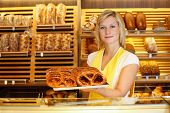 Shopkeeper In Bakery With Tablet Of Pretzels