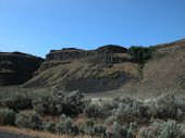 stock photo of sagebrush  - The Palisades is a central Washington canyon filled with rock mesas and sagebrush - JPG