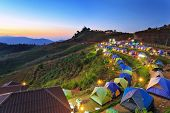 image of nightfall  - camping tent at dawn on the mountain in Chiangmai Thailand - JPG
