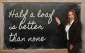 Teacher Showing Half A Loaf Is Better Than None On Blackboard