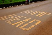 "stock photo of hump  - Road warning painted on the ground warning that there is a ""hump ahead"" in reference to a speed bump in Kigali Rwanda Africa