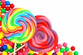 stock photo of lollipop  - Colorful candy corner border with lollipops and gumballs - JPG