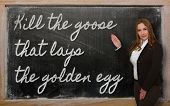 Teacher Showing Kill The Goose That Lays The Golden Egg On Blackboard