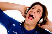 Portrait Of Shouting Male Enjoying Music