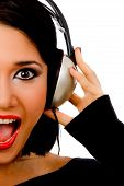 Portrait Of Happy Young Female Listening Music