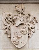 Heraldic shield stone in a pareto