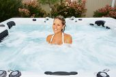 Beautiful woman relaxing in a hot tub. Vacation.