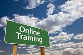 Online Training Green Road Sign with Dramatic Sky and Clouds.