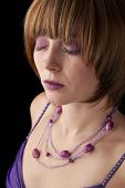 Beautiful luxury violet fashion portrait with dark background