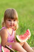 Summer Afternoon The Little Girl Eats Ripe Water-melon