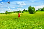 Girl Running With Kite