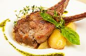 picture of scallion  - Roasted sheep meat with potatoes on dish in restaurant - JPG
