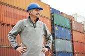 adult terminal cargo dock warehouse worker in front of maritime shipping container