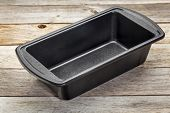 nonstick metal baking loaf pan on a wooden rustic table