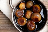 stock photo of vinegar  - Pickling onions pickled in dark balsamic vinegar - JPG