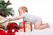 picture of boxing day  - Baby boy reaching for Christmas gifts - JPG
