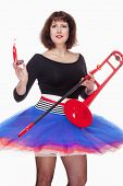 Young Female Musician With Red Trombone Dancing