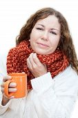 Ill woman holding a mug of tea with sore throat isolated on white background