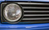 Close Up Old Of Automobile Grille And Headlight