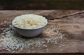 Rice With White Cup On Wooden Table.