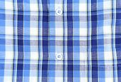 Plaid man shirt, button close-up background