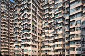 picture of overpopulation  - Overcrowded residential building in Hong Kong - JPG