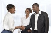 Three African Business Partner Shake Hands At Meeting