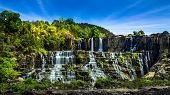 image of lats  - Tropical rainforest landscape panorama with flowing Pongour waterfall under blue sky - JPG