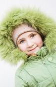 Smiling Child In Fur Hood
