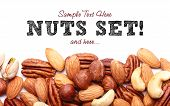 stock photo of pecan nut  - Background texture of assorted mixed nuts including cashew nuts pecan nuts almonds - JPG