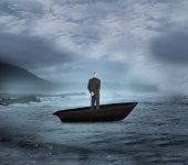 Composite image of rear view of mature businessman posing in a sailboat on open water