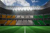 Ivory coast national flag in large football stadium with white fans