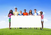 Multi-Ethnic Teenagers Outdoors Holding Empty Billboard for Copy Space