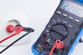 Plug socket and multimeter