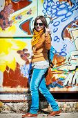 picture of cuckold  - Young caucasian woman standing with painted wall - JPG